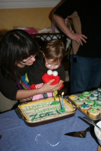 blowing out the candles on my oh-so-beautifully decorated cake