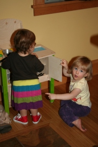 cooking is always more fun with a friend.  (and check out the super-cute red Chuck Taylors from Aunt Liz).