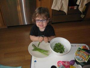 preparing fresh asparagus for dinner - she loves helping to cook