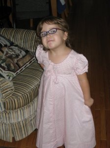 Zoe in the dress my mom made for me when I was her age